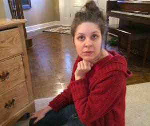 Bess sitting in the floor