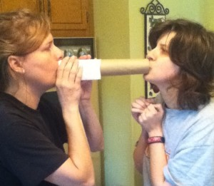 Mom talking to Jess through a paper towel roll