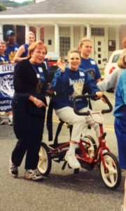 Jess Riding Tricycle in Special Olympics Parade