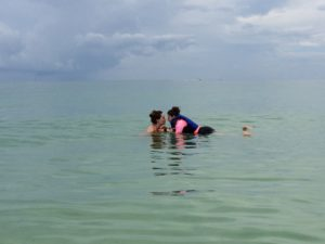 Two sisters, one with Autism, floating alone in the calm waters of the Gulf of Mexico.