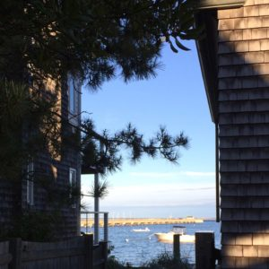 A view of the bay between two houses in Provincetown, MA
