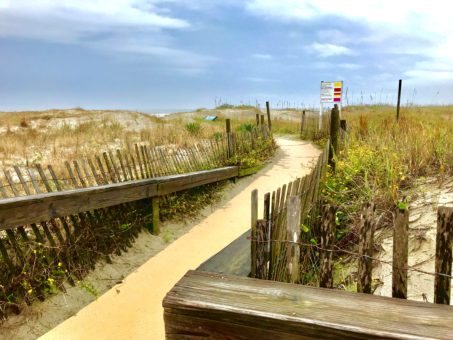 Public access walkway to the beach on Kiawah Island. Blue sky and white whips clouds.