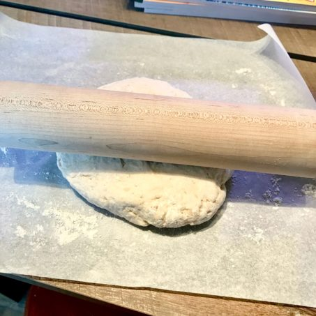 Biscuit Dough with a rolling pin on top