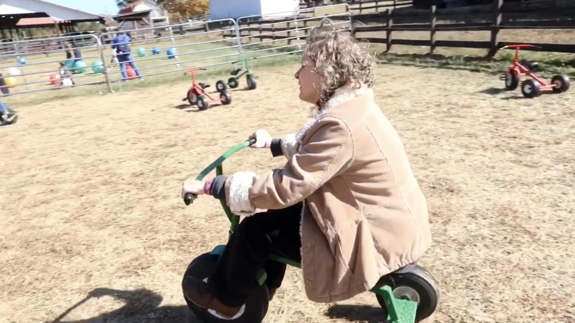 Jess riding a trike