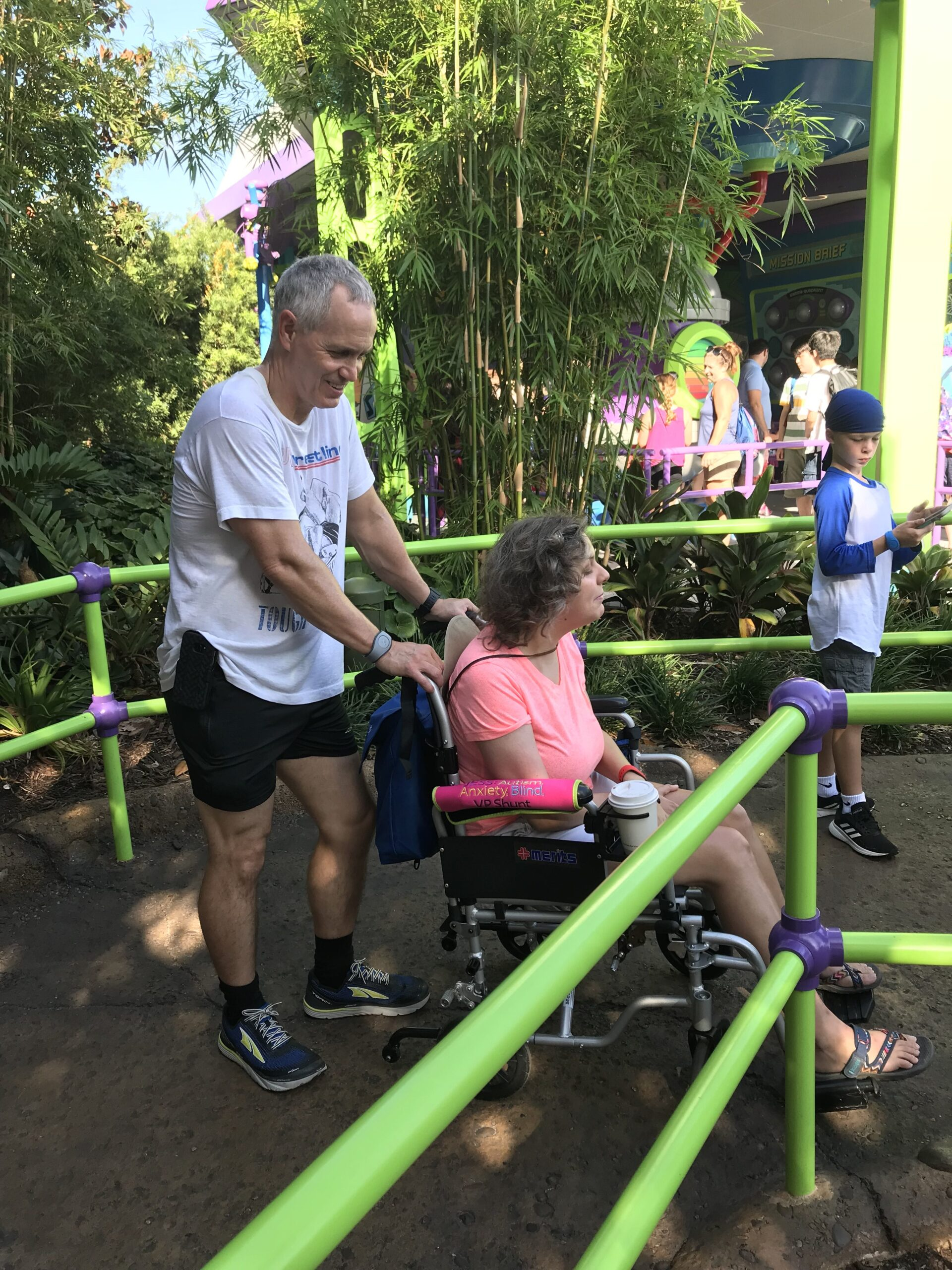 Jess is being pushed in a wheelchair at Disney World