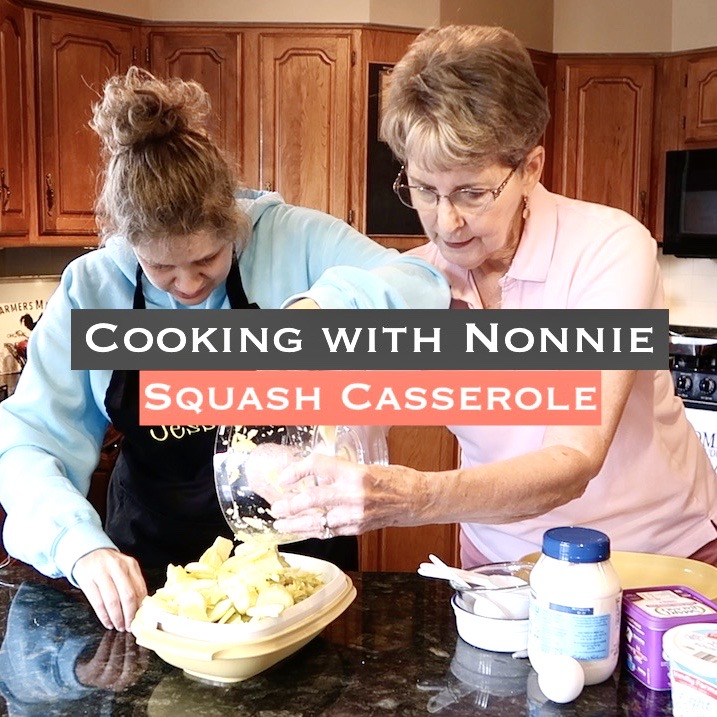 Jess and Nonnie at the counter in Nonnie's kitchen, pouring sliced squash into a microwavable steamer.